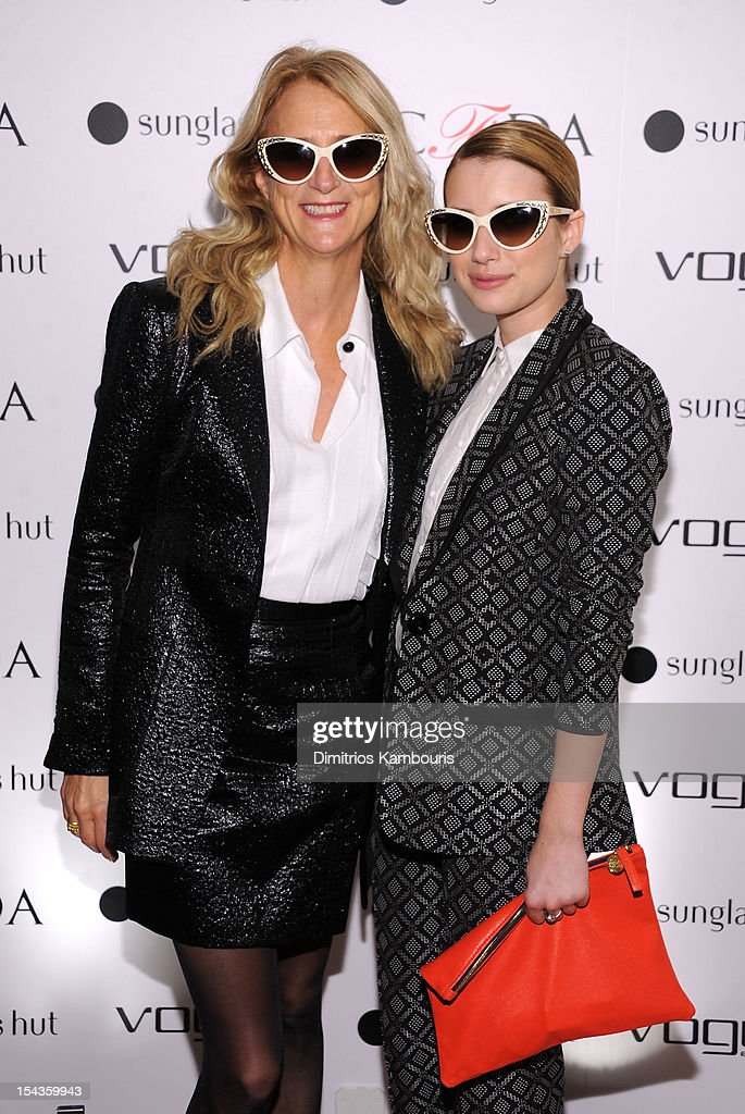 Designer Nanette Lepore (L) and actress Emma Roberts attend the Vogue Eyewear and CFDA unveiling of the 'Emma' sunglass with Nanette Lepore and Emma Roberts at Sunglass Hut on October 18, 2012 in New York City.