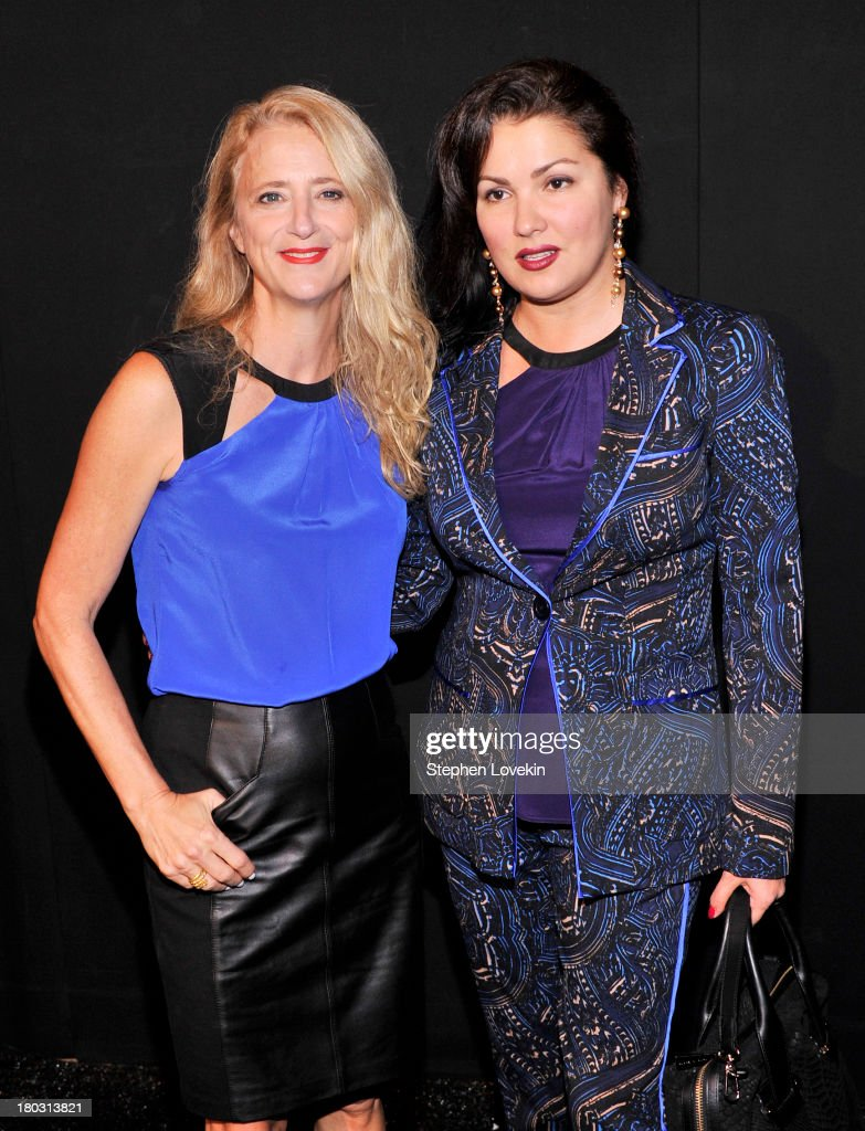 Designer (L) Nanette Lepore and opera singer Anna Netrebko pose backstage at the Nanette Lepore fashion show during Mercedes-Benz Fashion Week Spring 2014 at The Stage at Lincoln Center on September 11, 2013 in New York City.