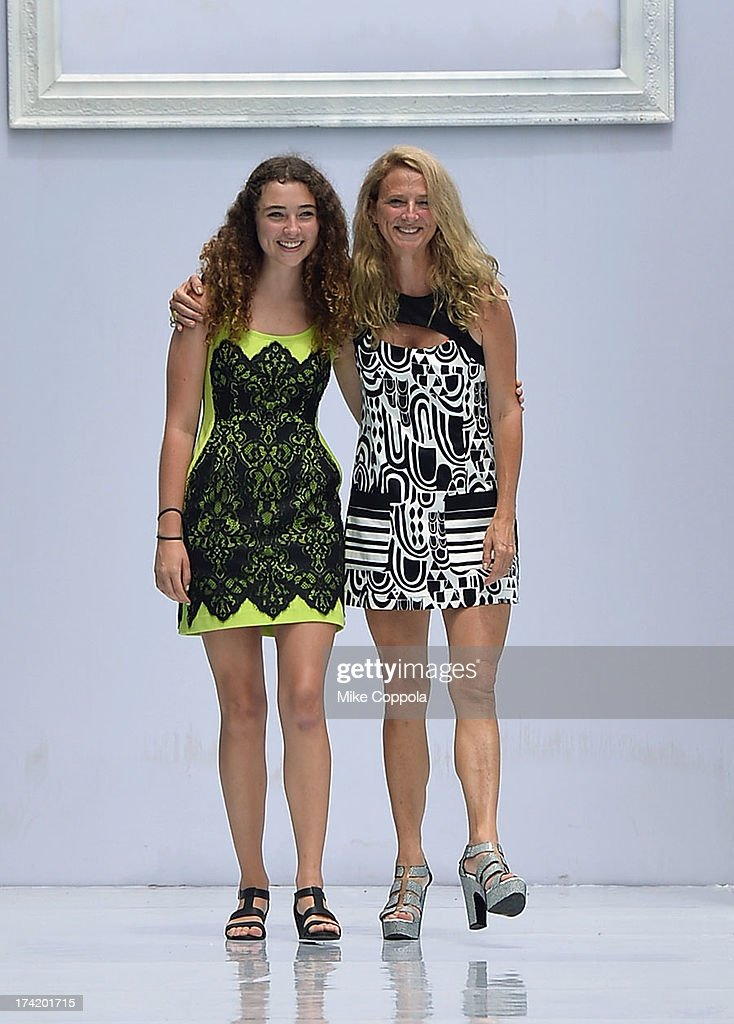 Designer <a gi-track='captionPersonalityLinkClicked' href=/galleries/search?phrase=Nanette+Lepore+-+Fashion+Designer&family=editorial&specificpeople=5410475 ng-click='$event.stopPropagation()'>Nanette Lepore</a> (R) and Violet Lepore pose on the runway during the <a gi-track='captionPersonalityLinkClicked' href=/galleries/search?phrase=Nanette+Lepore+-+Fashion+Designer&family=editorial&specificpeople=5410475 ng-click='$event.stopPropagation()'>Nanette Lepore</a> Swim Press Preview during Mercedes-Benz Fashion Week Swim 2014 at the SLS Hotel on July 21, 2013 in Miami, Florida.