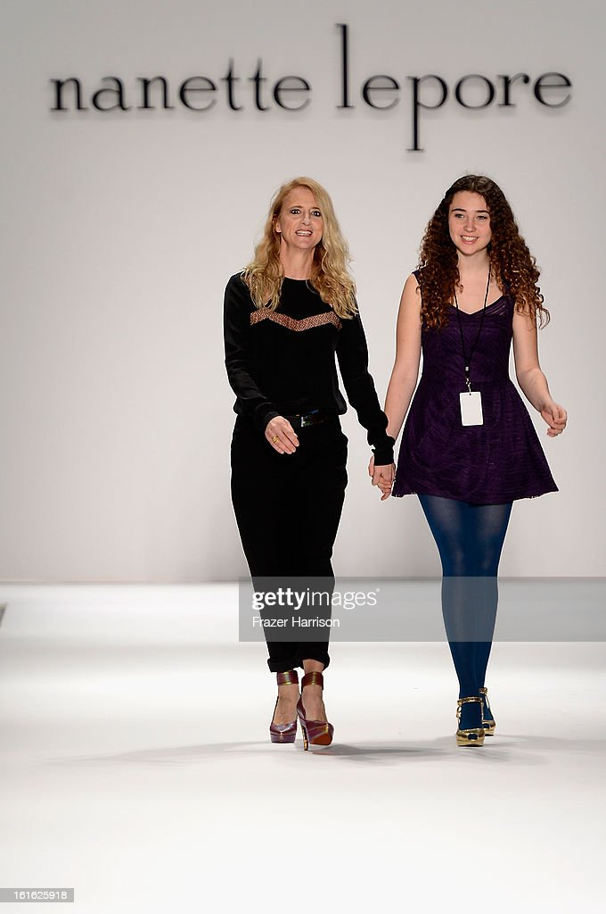 Designer Nanette Lepore and Violet Lepore walk the runway at the Nanette Lepore Fall 2013 fashion show during Mercedes-Benz Fashion Week at The Stage at Lincoln Center on February 13, 2013 in New York City.