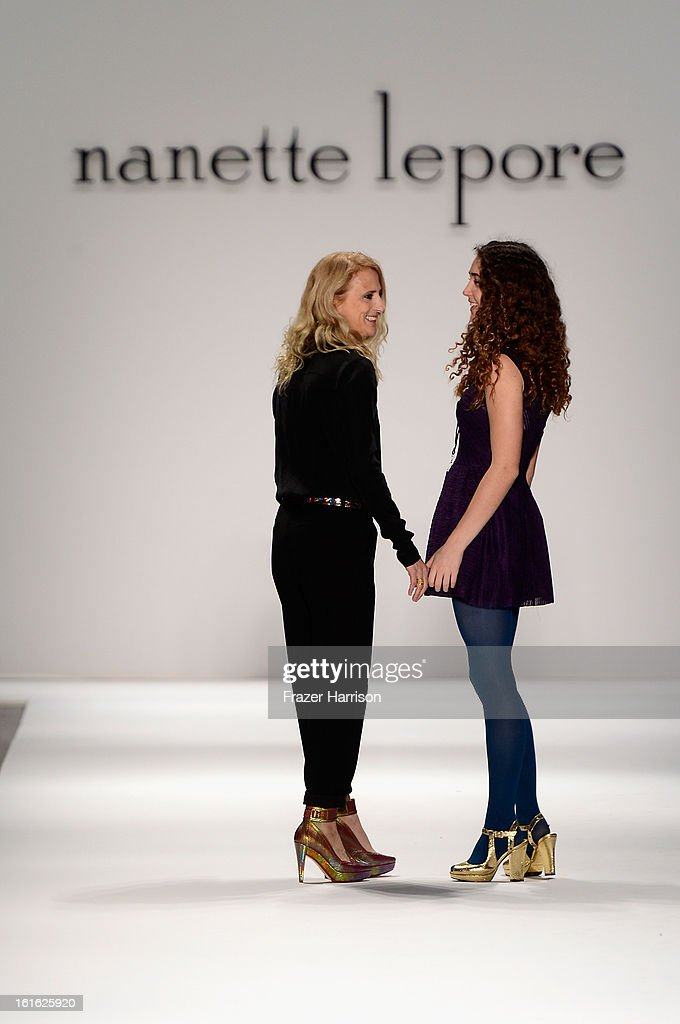 Designer <a gi-track='captionPersonalityLinkClicked' href=/galleries/search?phrase=Nanette+Lepore+-+Fashion+Designer&family=editorial&specificpeople=5410475 ng-click='$event.stopPropagation()'>Nanette Lepore</a> and Violet Lepore walk the runway at the <a gi-track='captionPersonalityLinkClicked' href=/galleries/search?phrase=Nanette+Lepore+-+Fashion+Designer&family=editorial&specificpeople=5410475 ng-click='$event.stopPropagation()'>Nanette Lepore</a> Fall 2013 fashion show during Mercedes-Benz Fashion Week at The Stage at Lincoln Center on February 13, 2013 in New York City.
