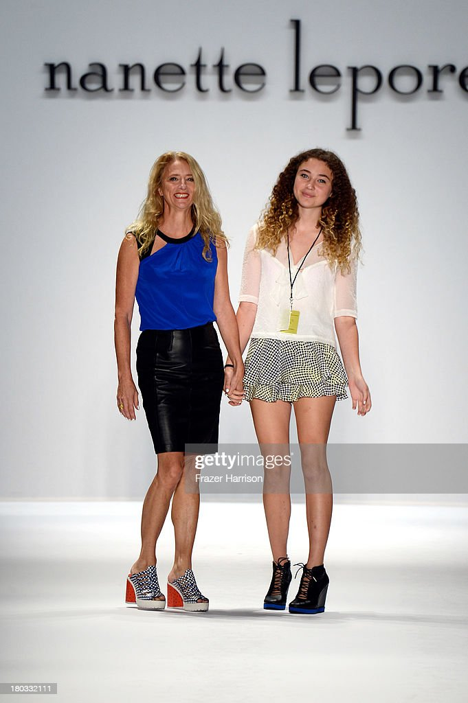 Designer <a gi-track='captionPersonalityLinkClicked' href=/galleries/search?phrase=Nanette+Lepore+-+Fashion+Designer&family=editorial&specificpeople=5410475 ng-click='$event.stopPropagation()'>Nanette Lepore</a> and Violet Lepore walk the runway at the <a gi-track='captionPersonalityLinkClicked' href=/galleries/search?phrase=Nanette+Lepore+-+Fashion+Designer&family=editorial&specificpeople=5410475 ng-click='$event.stopPropagation()'>Nanette Lepore</a> fashion show during Mercedes-Benz Fashion Week Spring 2014 on September 11, 2013 in New York City.
