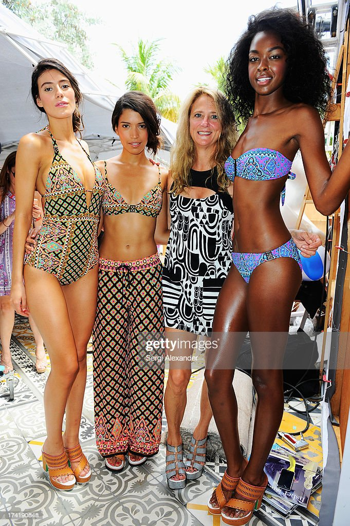 Designer <a gi-track='captionPersonalityLinkClicked' href=/galleries/search?phrase=Nanette+Lepore+-+Fashion+Designer&family=editorial&specificpeople=5410475 ng-click='$event.stopPropagation()'>Nanette Lepore</a> poses with models at the <a gi-track='captionPersonalityLinkClicked' href=/galleries/search?phrase=Nanette+Lepore+-+Fashion+Designer&family=editorial&specificpeople=5410475 ng-click='$event.stopPropagation()'>Nanette Lepore</a> Swim Press Preview during Mercedes-Benz Fashion Week Swim 2014 at the SLS Hotel on July 21, 2013 in Miami, Florida.