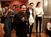 Designer Narciso Rodriguez enjoys a moment backstage before the Narciso Rodriguez fashion show during Spring 2016 New York Fashion Week at SIR...