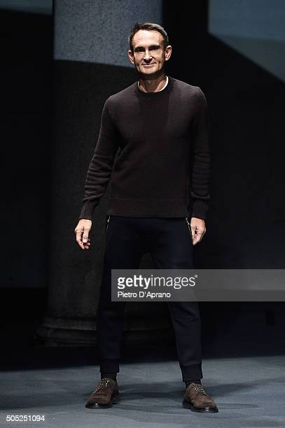Designer Neil Barrett acknowledges the applause of the public after the Neil Barrett show during Milan Men's Fashion Week Fall/Winter 2016/17 on...