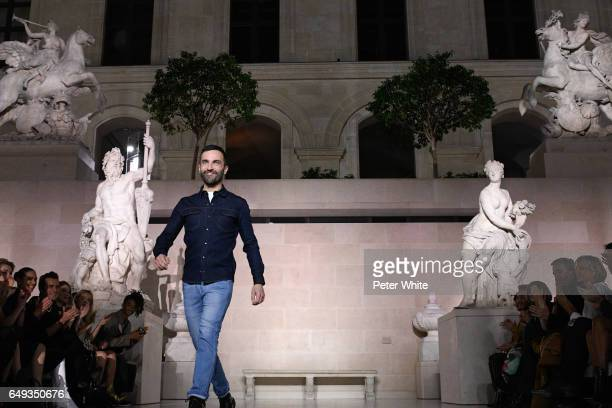 Designer Nicholas Ghesquiere walks the runway after the Louis Vuitton show as part of the Paris Fashion Week Womenswear Fall/Winter 2017/2018 on...