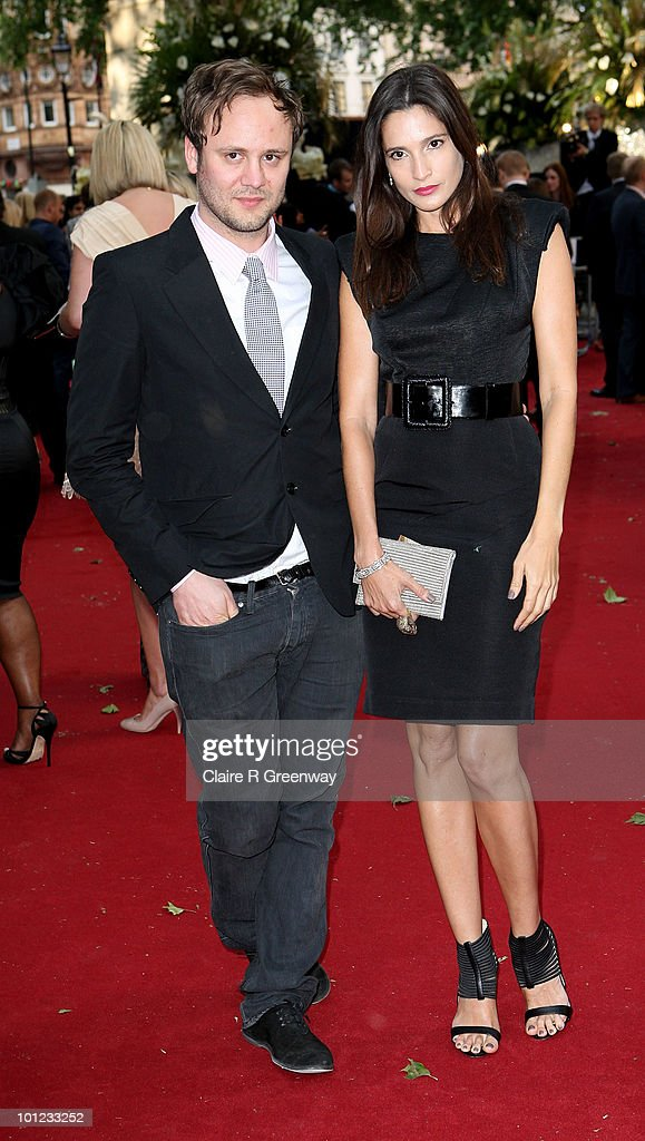 Designer Nicholas Kirkwood and model Astrid Munoz arrive at the UK premiere of Sex And The City 2 at Odeon Leicester Square on May 27, 2010 in London, England.