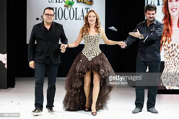 Designer Nicolas Fafiotte actress Dounia Coesens and chocolate maker Sebastien Bouillet walk the runway during the Fashion Chocolate Show at Salon du...