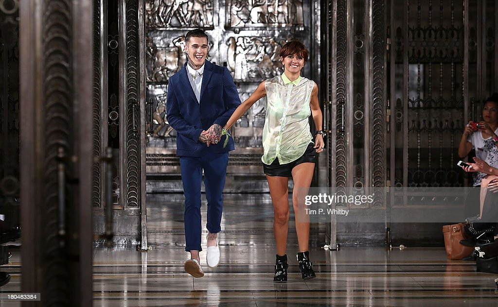 Designer Nihan Buruk (left) and a model walk the runway at the Yeashin show during at the Fashion Scout venue during London Fashion Week SS14 at Freemasons Hall on September 13, 2013 in London, England.