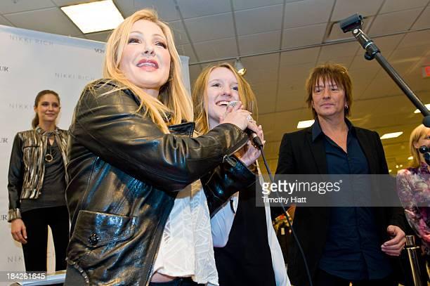 Designer Nikki Lund Starlight Foundation representative Emily Muller and Richie Sambora attend the Nikki Rich Launch With CoDesigners Lund And...