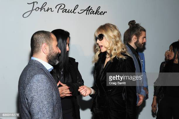 Designer Numan Ataker and a guest attend the John Paul Ataker Fall Winter 2017 Runway Show at Pier 59 on February 14 2017 in New York City