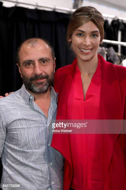 Designer Numan Ataker and a model pose backstage for John Paul Ataker fashion show during New York Fashion Week The Shows at Gallery 1 Skylight...