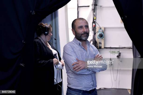 Designer Numan Ataker prepares backstage for John Paul Ataker fashion show during New York Fashion Week The Shows at Gallery 1 Skylight Clarkson Sq...
