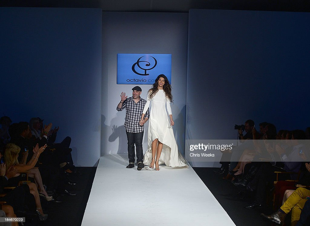 Designer Octavio Carlin and his model walk the runway at the Octavio Carlin Spring 2014 collection show at Style Fashion Week on October 14, 2013 in Los Angeles, California.