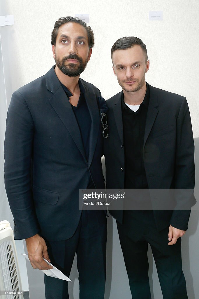 Designer of perfumes Byredo Ben Gorham and Fashion designer Kris Van Assche backstage after Dior Homme Menswear Spring/Summer 2014 Show as part of the Paris Fashion Week on June 29, 2013 in Paris, France.