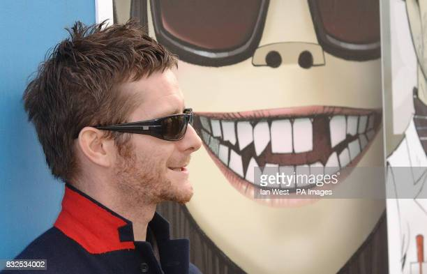 Designer of the Year Jamie Hewlett with some of his Gorillaz artwork covering hoardings at the South Bank as limited editions of the Gorillaz'...