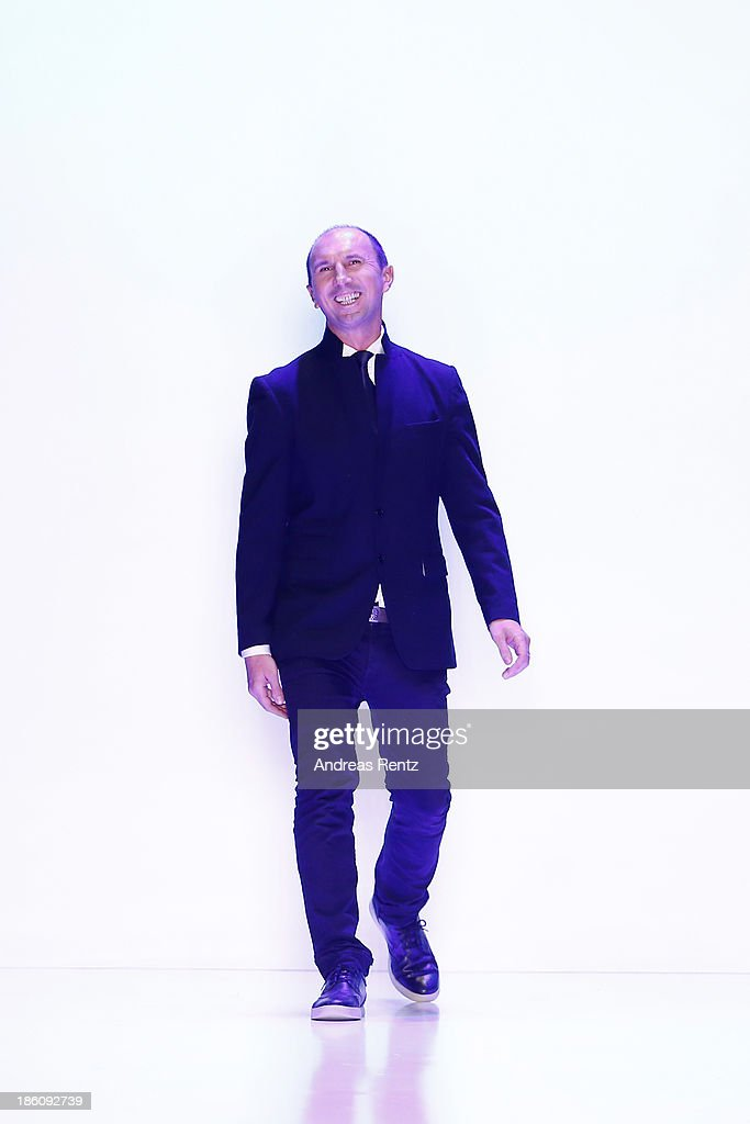 Designer Oleg Biryzkov on the runway after the Biryzkov show during Mercedes-Benz Fashion Week Russia S/S 2014 on October 28, 2013 in Moscow, Russia.