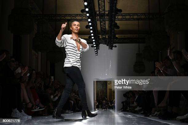Designer Olivier Rousteing acknowledges the audience at the end of the Balmain Menswear Spring/Summer 2018 show as part of Paris Fashion Week on June...