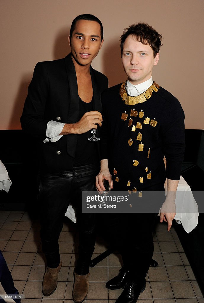 Designer Olivier Rousteing and Alex Fury attend the Katie Grand & Olivier Rousteing LOVE Christmas Party, hosted by Balmain, at Shrimpy's on December 18, 2012 in London, England.