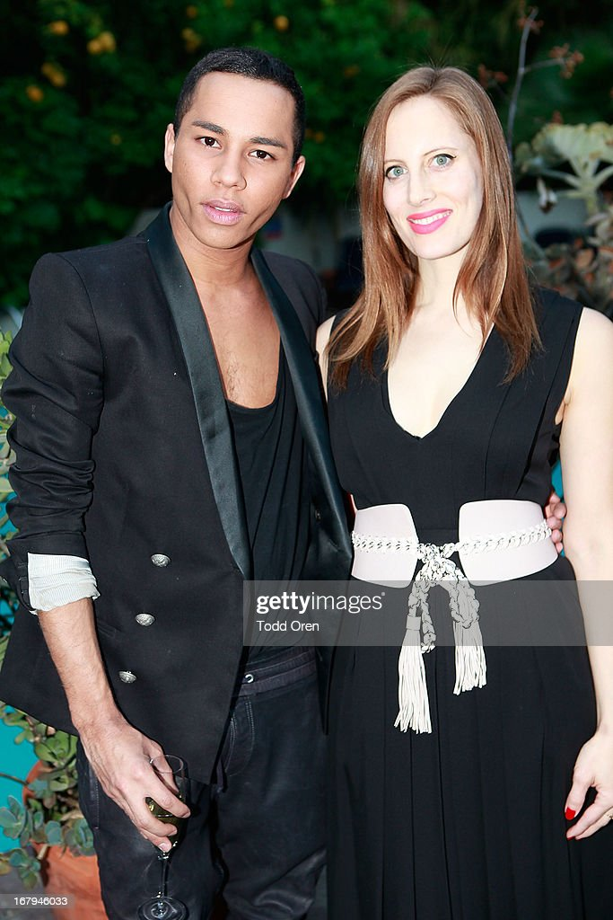Designer Olivier Rousteing and Liz Goldwyn pose at the Balmain LA Dinner at Chateau Marmont on May 2, 2013 in Los Angeles, California.
