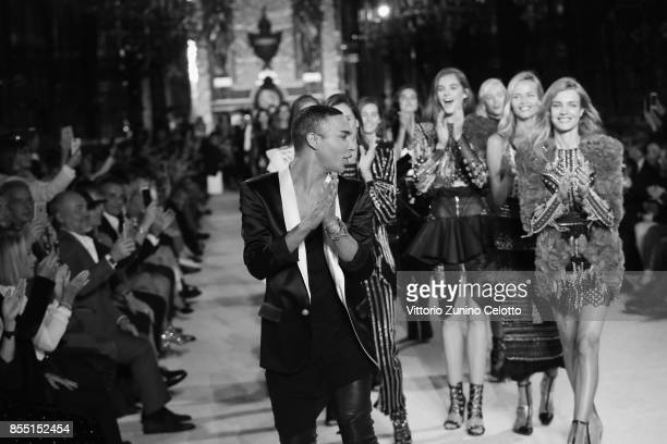 Designer Olivier Rousteing and models Alessandra Ambrosio Natasha Poly and Natalia Vodianova acknowledge the applause of the public after the Balmain...
