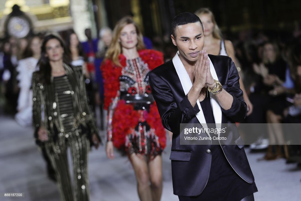 Designer Olivier Rousteing and models Alessandra Ambrosio, Natasha Poly and Natalia Vodianova acknowledge the applause of the public after the Balmain show as part of the Paris Fashion Week Womenswear Spring/Summer 2018 on September 28, 2017 in Paris, France.