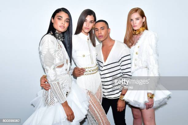 Designer Olivier Rousteing poses with models at the Balmain Menswear Spring/Summer 2018 show as part of Paris Fashion Week on June 24 2017 in Paris...