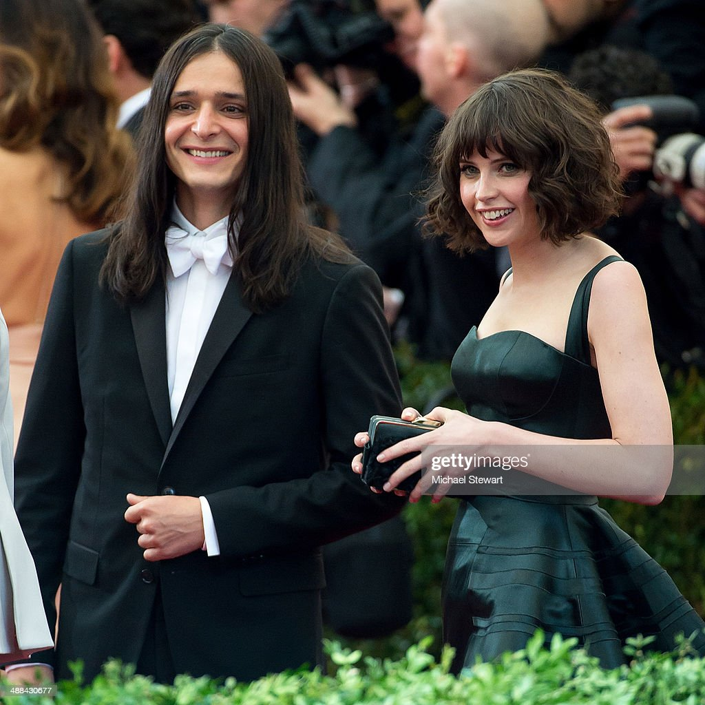 Designer Olivier Theyskens (L) and actress Felicity Jones attend the 'Charles James: Beyond Fashion' Costume Institute Gala at the Metropolitan Museum of Art on May 5, 2014 in New York City.