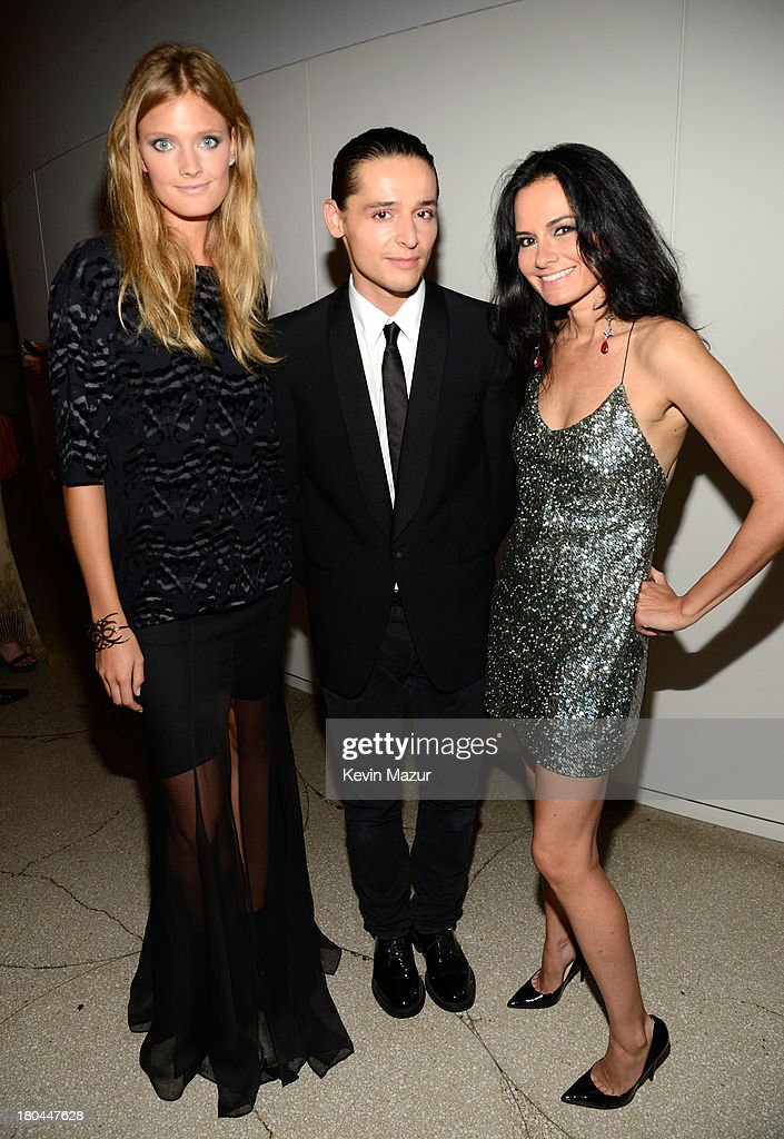 Designer Olivier Theyskens (R) and model Constance Jablonski (L) attend the Estee Lauder 'Modern Muse' Fragrance Launch Party at the Guggenheim Museum on September 12, 2013 in New York City.