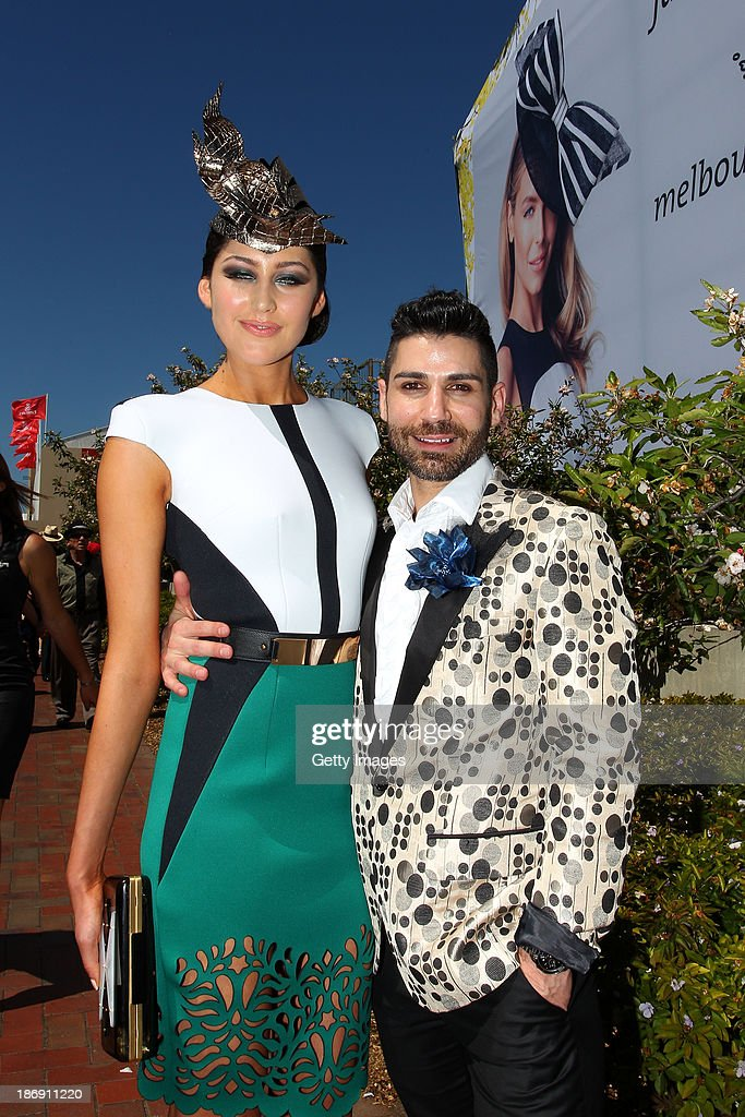 Designer Oscar Calvo poses with a model after winning the Design Award at Myer Fashions On The Field during Melbourne Cup Day at Flemington Racecourse on November 5, 2013 in Melbourne, Australia.