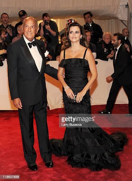 Designer Oscar de la Renta and actress Penelope Cruz attend the 'Alexander McQueen Savage Beauty' Costume Institute Gala at The Metropolitan Museum...