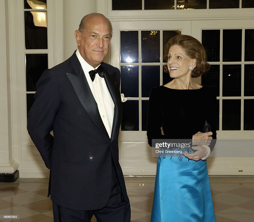 Designer Oscar de la Renta and his wife Annette De La Renta, Vice-Chairman of the Metropolitan Museum of Art, walk through the Booksellers room in the White House en route to a social dinner in honor of TRH Prince Charles, Prince of Wales, and his wife Camilla, Duchess of Cornwall, on November 2, 2005 in Washington, DC. The dinner is hosted by U.S. President George W. Bush and the first lady.