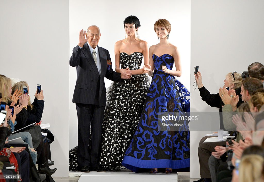 Designer Oscar De La Renta (L) and Model <a gi-track='captionPersonalityLinkClicked' href=/galleries/search?phrase=Karlie+Kloss&family=editorial&specificpeople=5555876 ng-click='$event.stopPropagation()'>Karlie Kloss</a> (C) pose on the runway at the Oscar De La Renta fashion show during Mercedes-Benz Fashion Week Fall 2014 on February 11, 2014 in New York City.