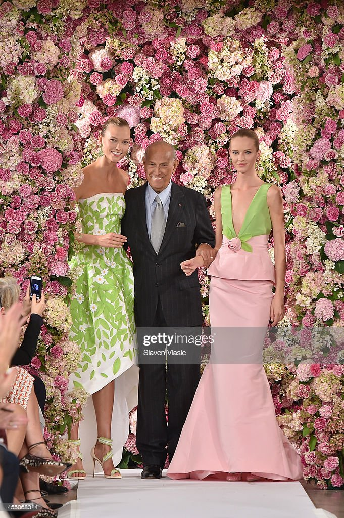 Designer Oscar de la Renta (C) and model Karlie Kloss (L) walk the runway at the Oscar De La Renta fashion show during Mercedes-Benz Fashion Week Spring 2015 on September 9, 2014 in New York City.