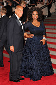 Designer Oscar de la Renta and Oprah attend the Costume Institute Gala Benefit to celebrate the opening of the 'American Woman Fashioning a National...
