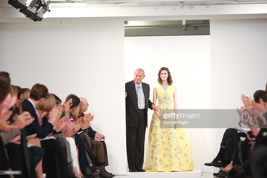 Designer <a gi-track='captionPersonalityLinkClicked' href=/galleries/search?phrase=Oscar+de+la+Renta+-+Fashion+Designer&family=editorial&specificpeople=4301010 ng-click='$event.stopPropagation()'>Oscar de la Renta</a> attends the <a gi-track='captionPersonalityLinkClicked' href=/galleries/search?phrase=Oscar+de+la+Renta+-+Fashion+Designer&family=editorial&specificpeople=4301010 ng-click='$event.stopPropagation()'>Oscar de la Renta</a> Pre-Fall 2013 Collection on December 10, 2012 in New York City.