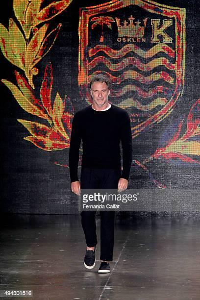 Designer Oskar Metsavaht walks the runway after the Osklen fashion show at Sao Paulo Fashion Week Winter 2016 on October 21 2015 in Sao Paulo Brazil