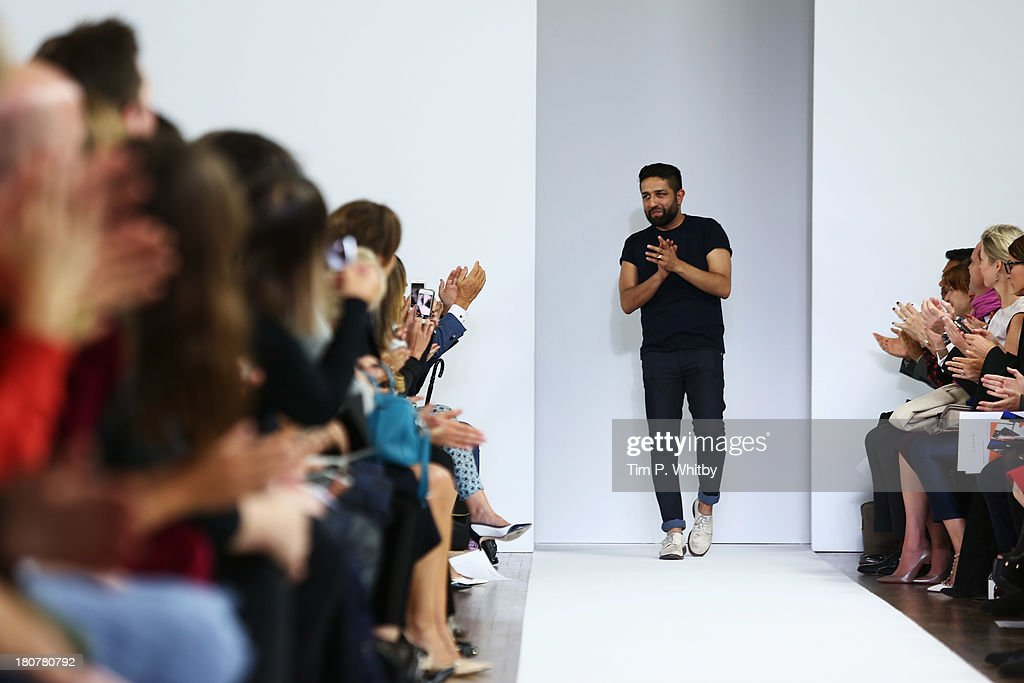 Designer Osman Yousefzada acknowledges the audience after the Osman show during London Fashion Week SS14 at Victoria House on September 16, 2013 in London, England.
