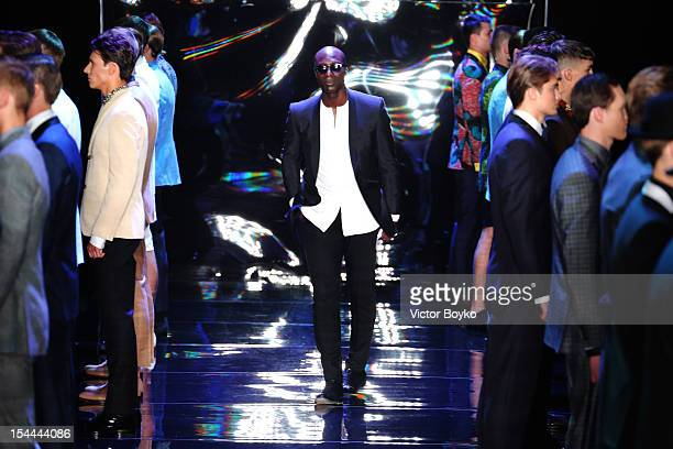 Designer Ozwald Boateng joins the models on the runway after the Ozwald Boateng Spring/Summer 2013 show on day 3 of MercedesBenz Fashion Week Russia...