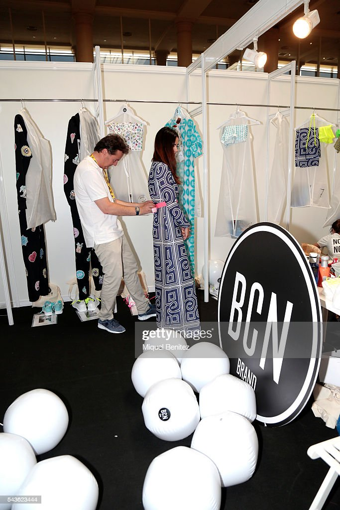 Designer Pablo Caralps (L) and a model attend at the backstage of BCN Brand as part of Barcelona 080 Fashion Week Spring/Summer 2017 at the INEFC Institut Nacional de Educacio Fisica de Catalunya on June 29, 2016 in Barcelona, Spain.