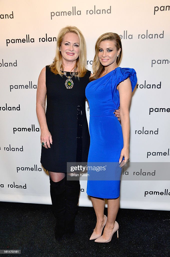 Designer Pamella Roland and actress Carmen Electra attend Pamella Roland during Fall 2013 Mercedes-Benz Fashion Week at The Studio at Lincoln Center on February 11, 2013 in New York City.
