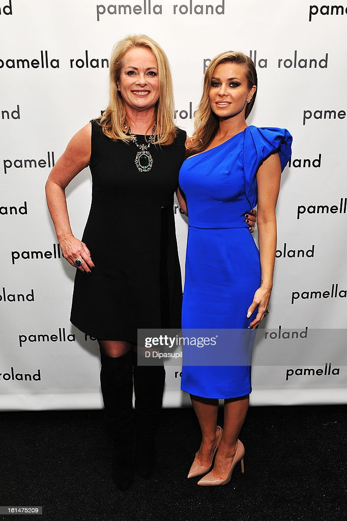 Designer Pamella Roland and model Carmen Electra backstage at the Pamella Roland Fall 2013 fashion show during Mercedes-Benz Fashion Week at at The Studio at Lincoln Center on February 11, 2013 in New York City.