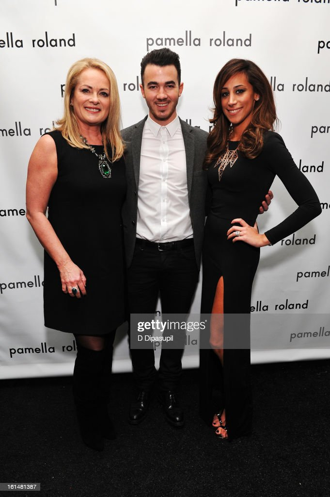 Designer Pamella Roland, musician Kevin Jonas, and wife Danielle Jonas pose backstage at the Pamella Roland Fall 2013 fashion show during Mercedes-Benz Fashion Week at at The Studio at Lincoln Center on February 11, 2013 in New York City.