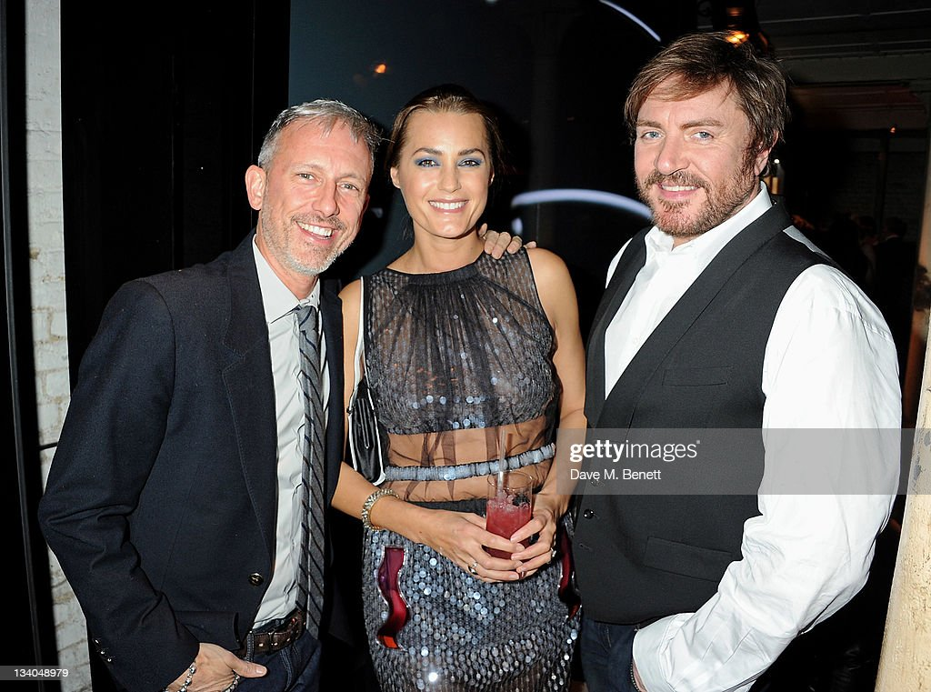 Designer Patrick Cox, model Yasmin Le Bon and musician Simon Le Bon attend the launch of the Vertu Constellation, the luxury mobile phone maker's first touchscreen handset, at the Farmiloe Building on November 24, 2011 in London, England.