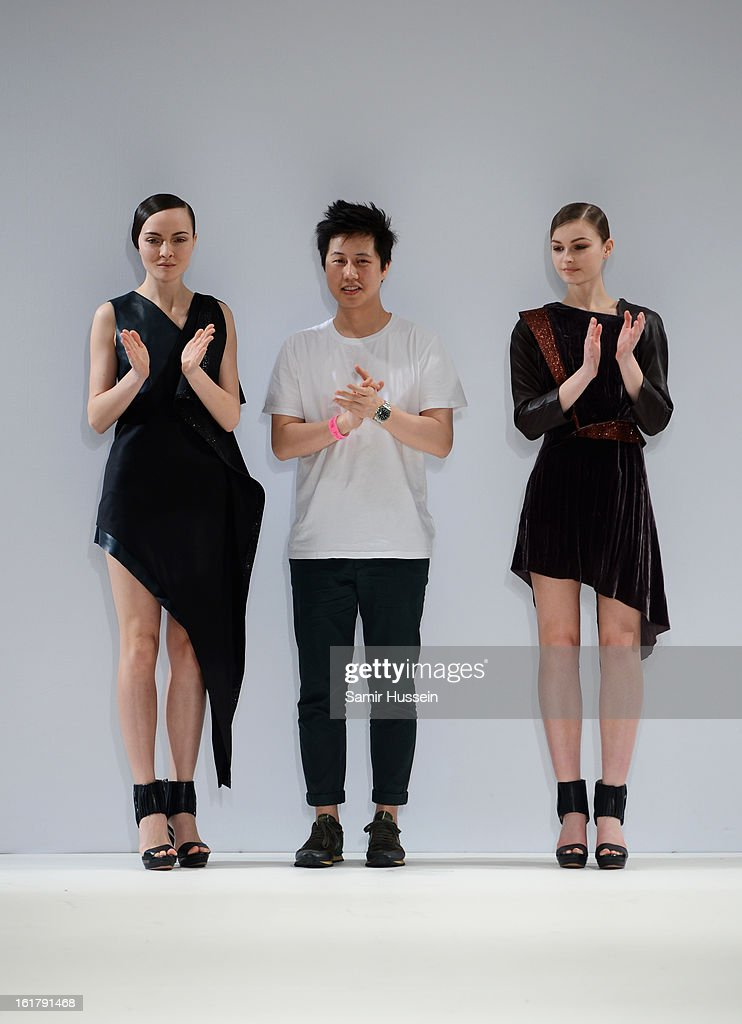 Designer Patrick Li walks the runway with models wearing his designs at the Ones To Watch show during London Fashion Week Fall/Winter 2013/14 at Freemasons Hall on February 16, 2013 in London, England.