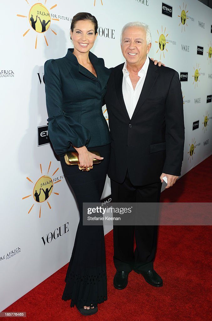 Designer Paul Marciano (R) and Mareva Georges Marciano attend Dream for Future Africa Foundation Inaugural Gala honoring Franca Sozzani of VOGUE Italia at Spago on October 24, 2013 in Beverly Hills, California.