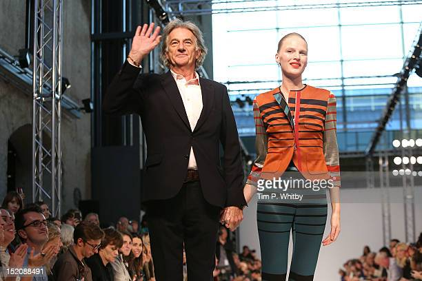 Designer Paul Smith and a model on the catwalk for the Paul Smith show on day 3 of London Fashion Week Spring/Summer 2013 at Central St Martins on...