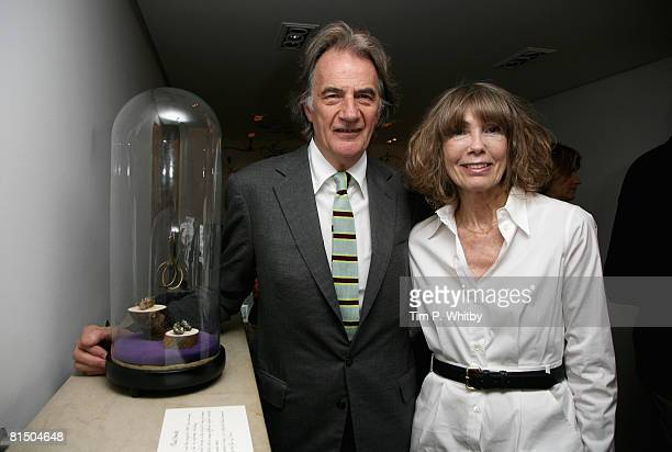 Designer Paul Smith and Pauline Smith pose beside one of the exhibits on display in the 'My Most Treasured' exhibition at Browns during the Private...