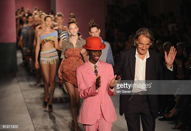 Designer Paul Smith appears on the runway with the models after his fashion show at Claridges Hotel during London Fashion Week on September 21 2009...