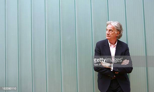 Designer Paul Smith poses backstage ahead of the Paul Smith show on day 3 of London Fashion Week Spring/Summer 2013 at Central St Martins on...